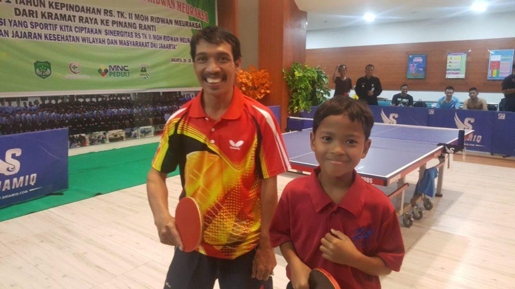 Guru dan murid menjadi lawan di turnamen